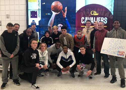 The team in Cleveland - group shot in front of Cavaliers mural