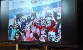 Students from CRS shown on a big screen at CES