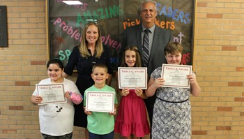 Four students with CES administrators.