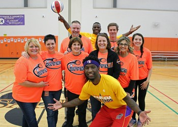 MS team members of the C-C Hoop Stars with visiting Harlem Wizards.