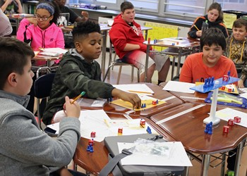 Middle School students employ manipulatives to understand the complex mathematical concepts they will soon be learning in algebra.