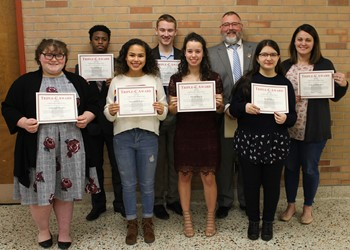 Shown here, left to right, with Principal Scott Wilson: Ashleigh Naugle, Kyle Louison, Savannah Perez, Christopher Bunk, Olivia Keefe, Betul Duru and Elissa Ostrander.