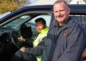 Churchville-Chili Security Officer Rick Allain (l) with Director of School Safety and Security William Sanborn in one of the district's MDC-equipped vehicles.