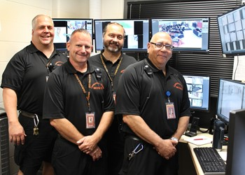 Security Worker John Schultz, Director of School Safety and Security Bill Sanborn, and Security Workers Bob Lillie and Tom Campopiano in Churchville-Chili's new Security Monitoring Center.