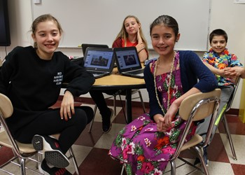 Sixth-graders get together at lunchtime every week to work on their plans for expanding recycling in their cafeteria.