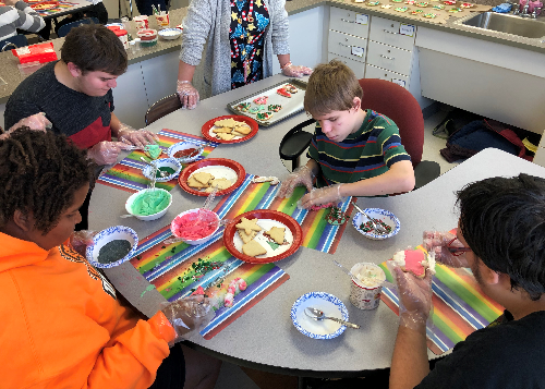 Group of students decorating cookies