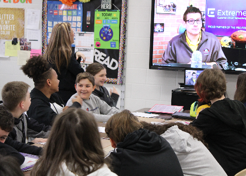 Students interacting with the presenter