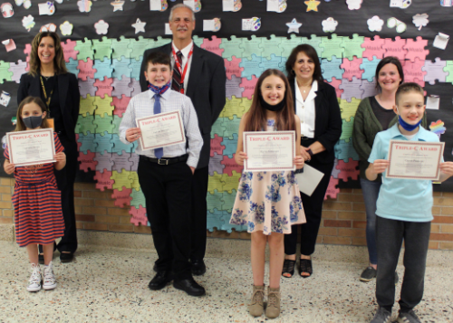 Six Triple C Award winners from CES with Principal and Director