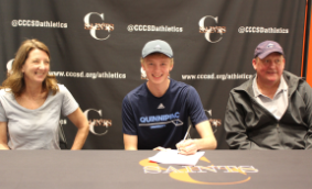 Senior Keegan Metcalfe (center) celebrates his signed commitment to compete for Quinnipiac University with his parents, Jane and Scott Metcalfe.