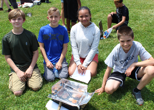 Team of four students with their solar cooker
