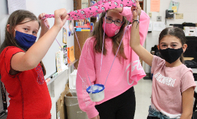 Three students with their protective egg parachute