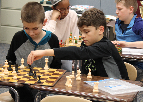 Students playing chess during the tournament