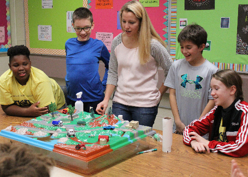 Students explore a 3-dimensional ecosystem model with Instructional Coach Andrea Lynch.