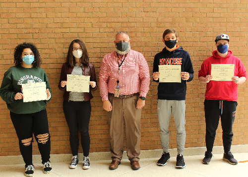 Four students with principal