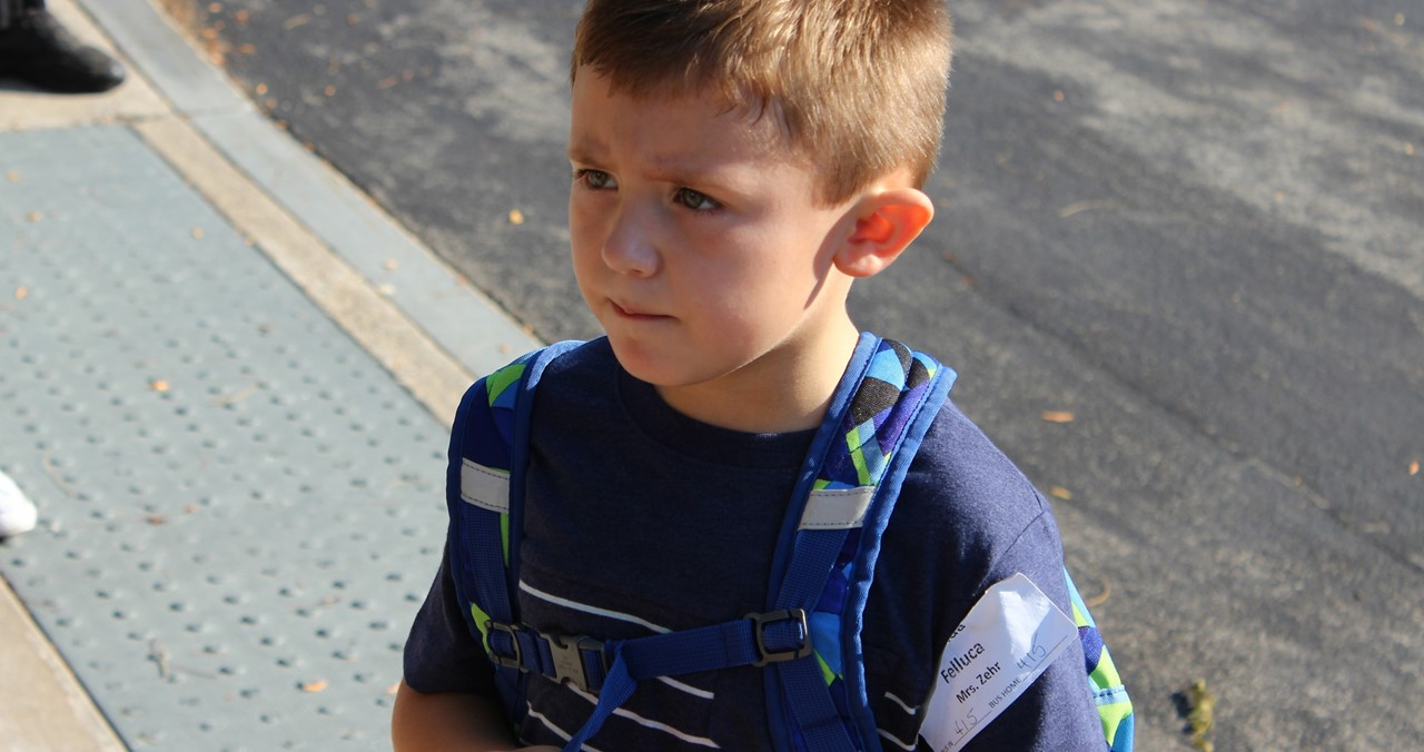 Close up of student with backpack.