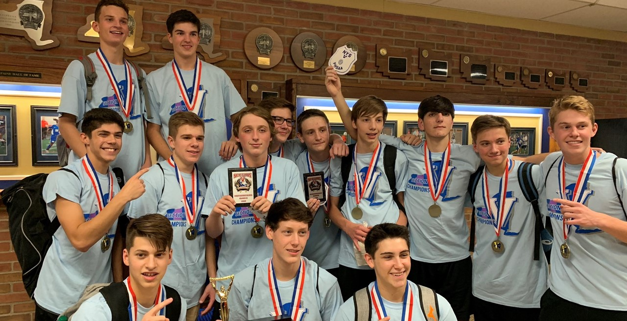 Boys Varsity Volleyball Team photo after winning Section V Class B title