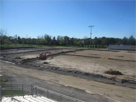 Construction vehicle working on athletic field