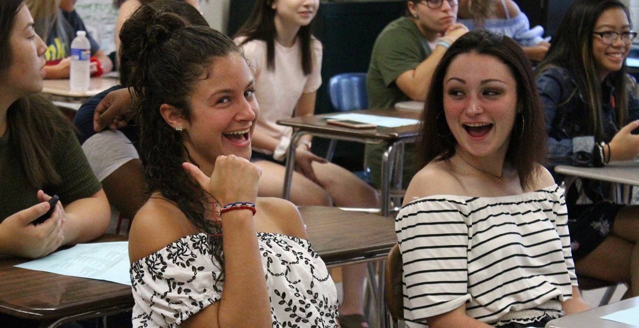 Students laughing in the classroom.