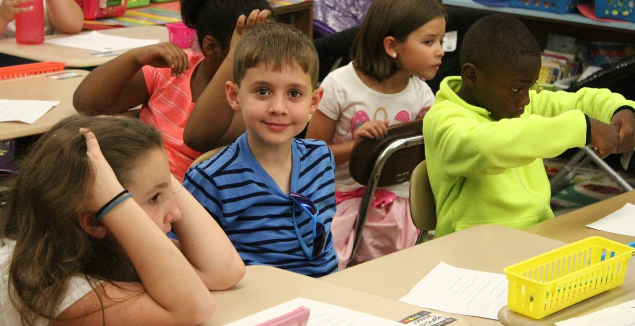 Children in class at CES.