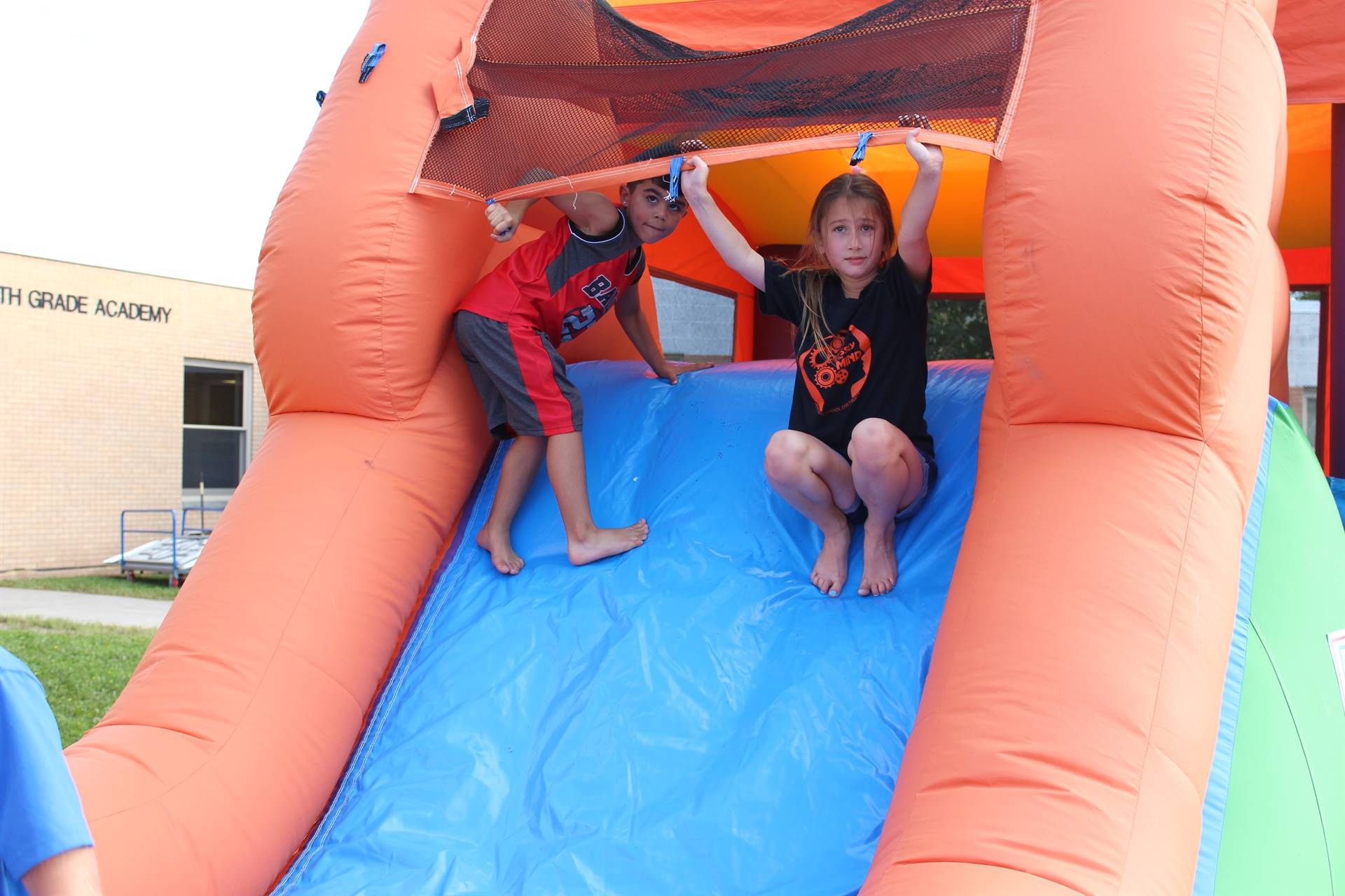 Two children in the bounce house.