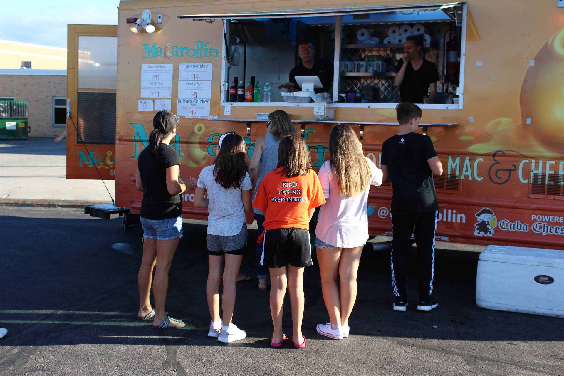 People line up in front of a food truck.
