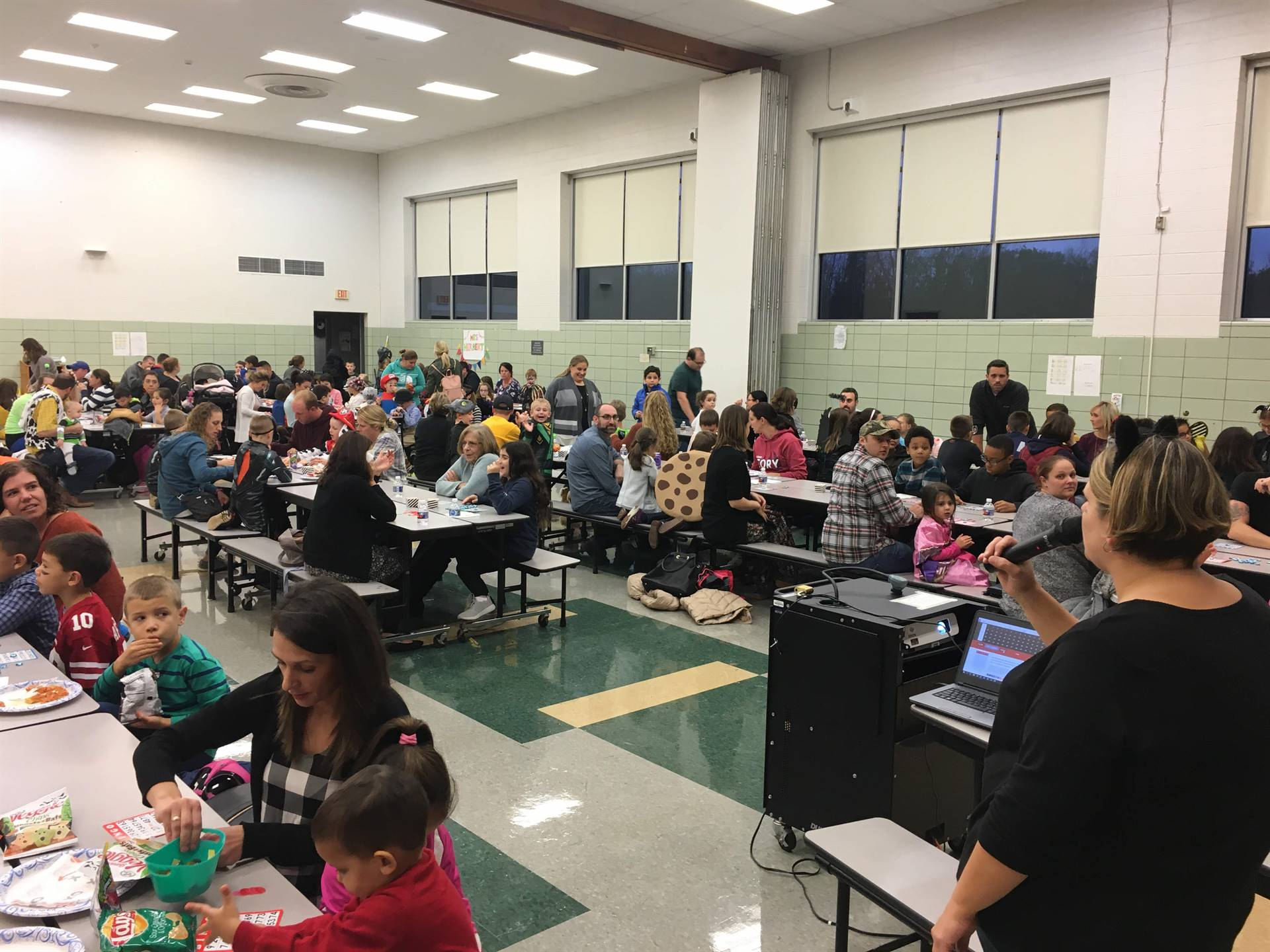 Families playing bingo in cafeteria