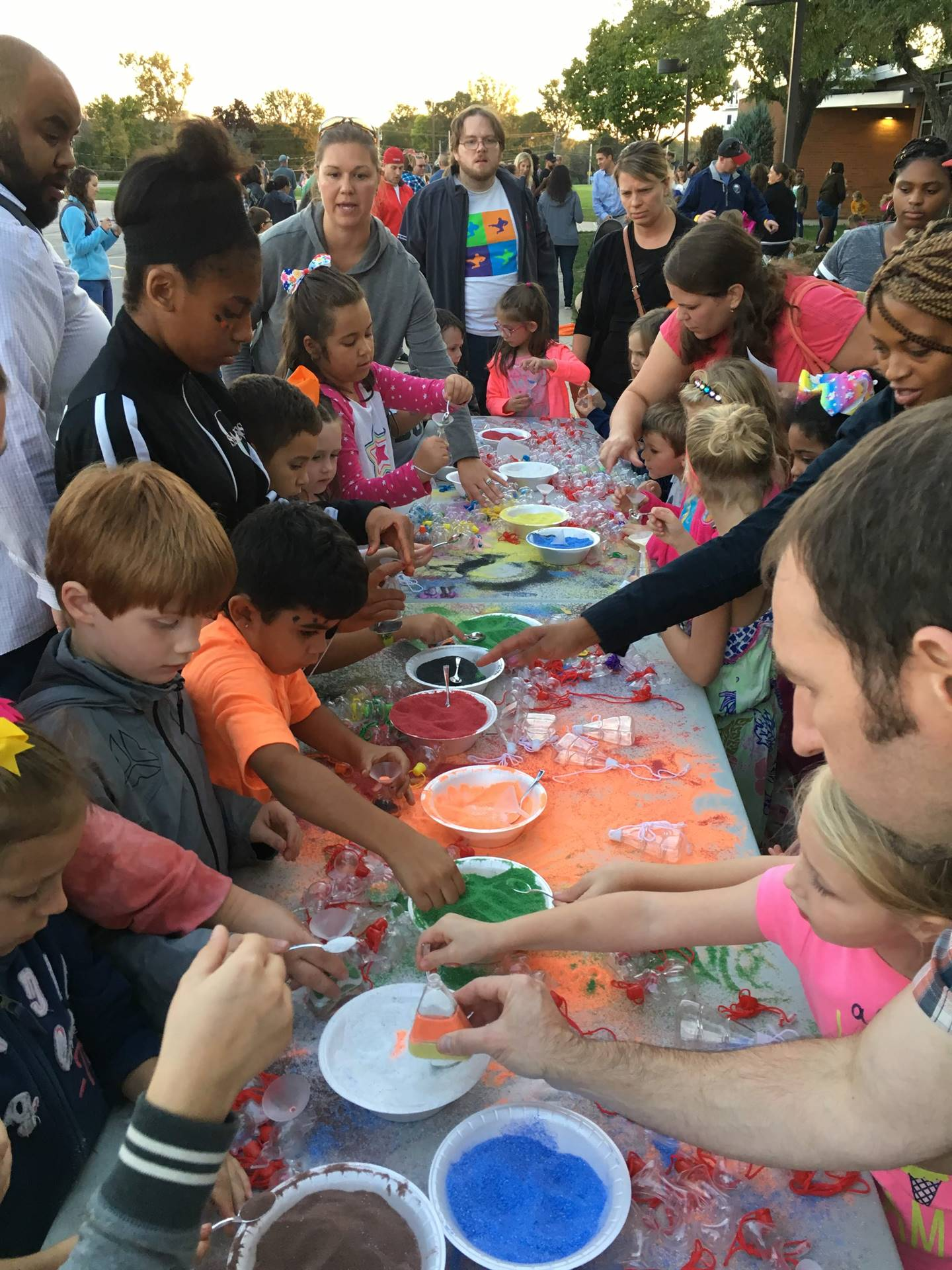 Families making crafts at Fall Festival