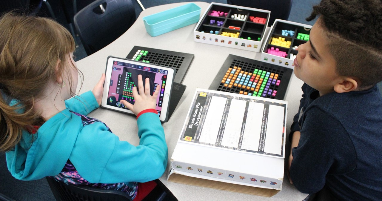 Third-graders working in the library with Bloxels