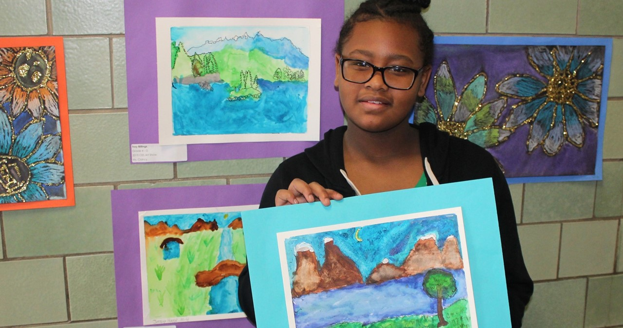Student with artwork.