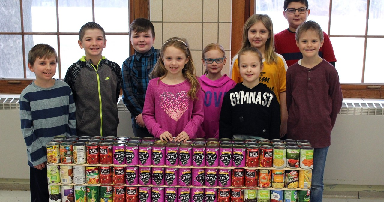 Students working on building their Canstruction.