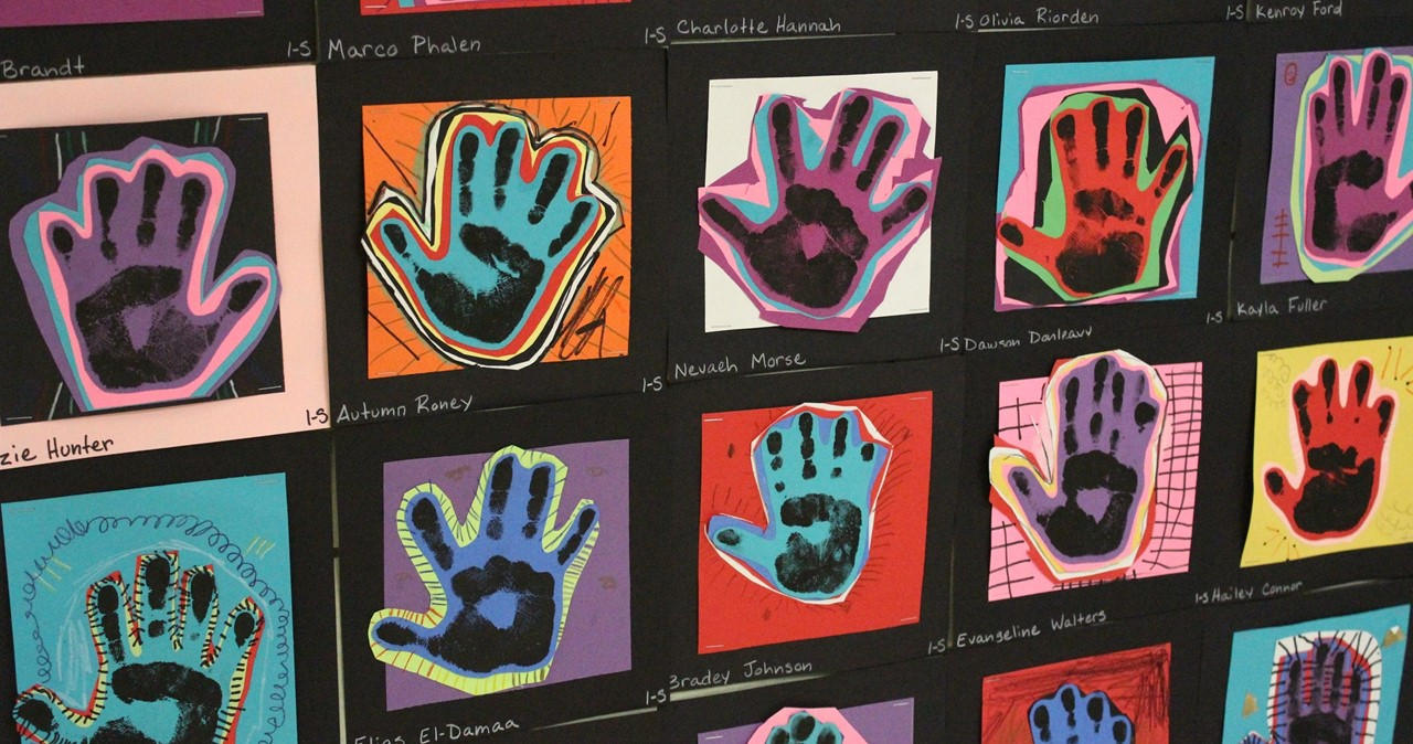 Artwork of brightly colored hands.