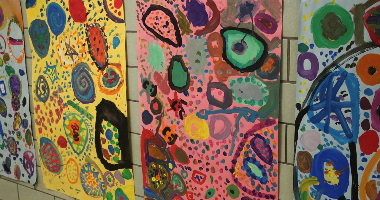Several dynamic brightly colored paintings.