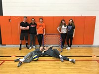 7 students posing for a picture after playing Tchoukball