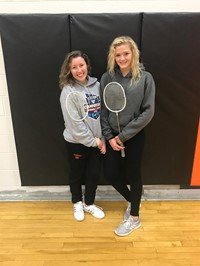2 Students with badminton racquets after playing badminton