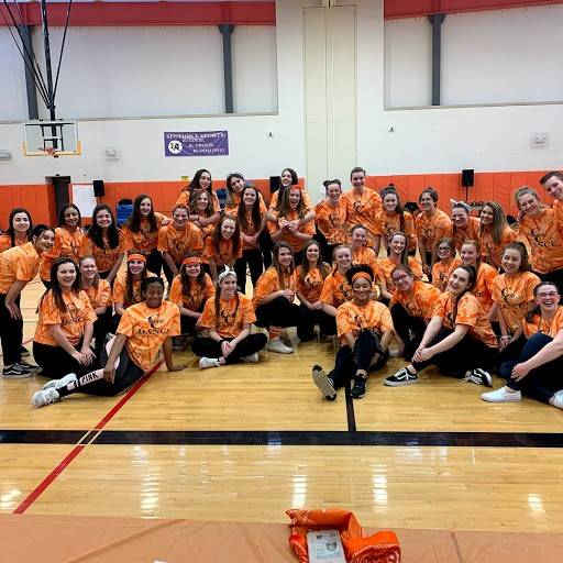 Students posing after pep rally dance