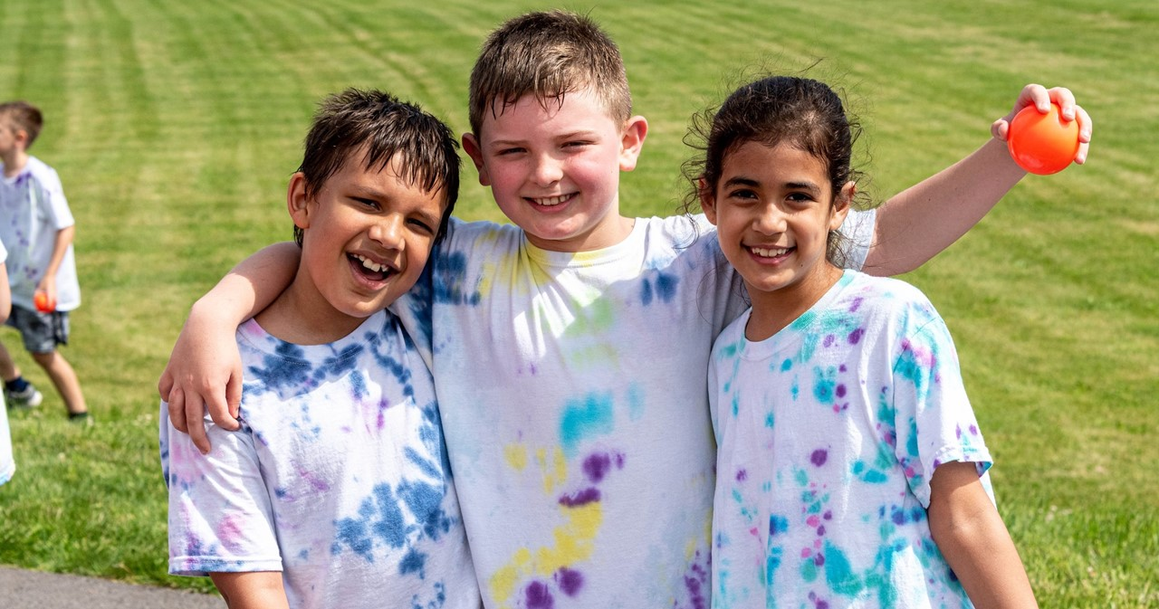 Three students wearing tie dyed Tshirts at FRS Field Days