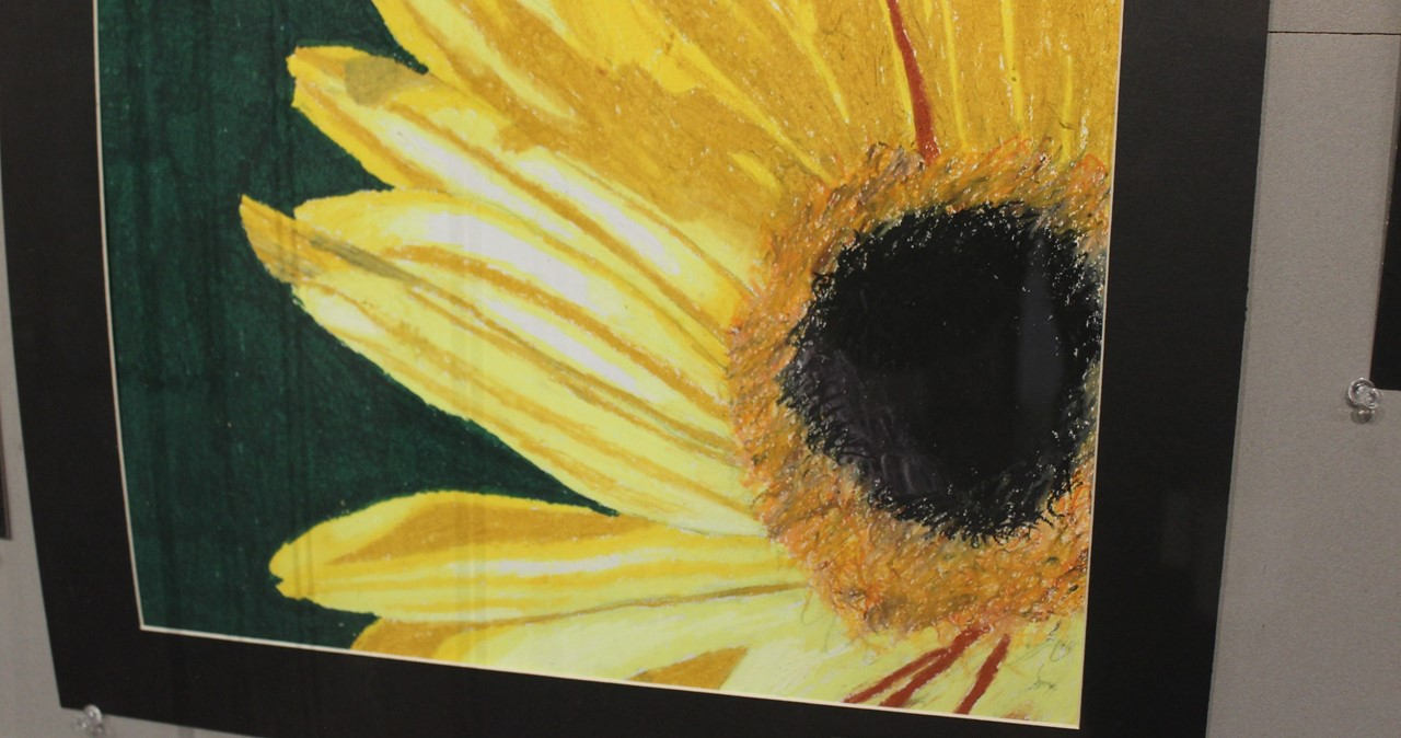 Large painting of sunflower at the HS