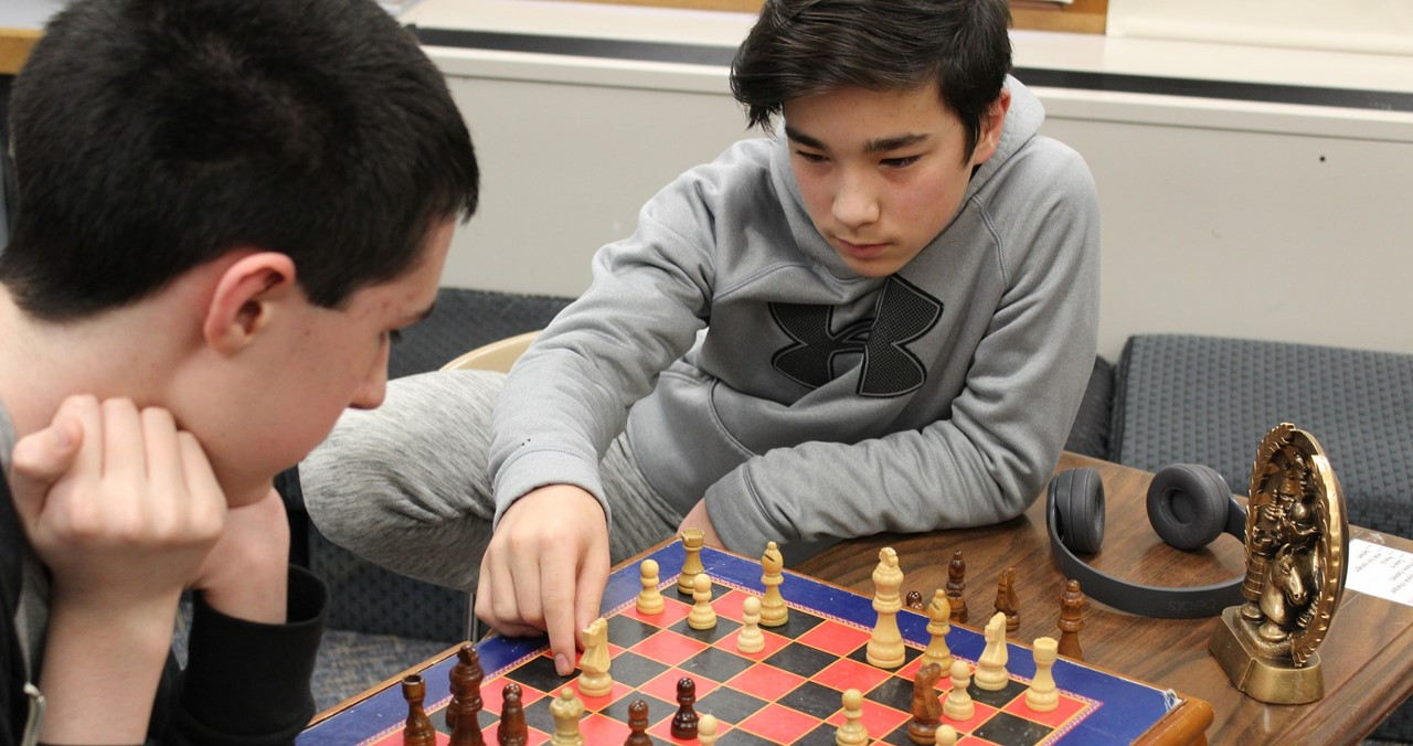 Two chess players intent on their game