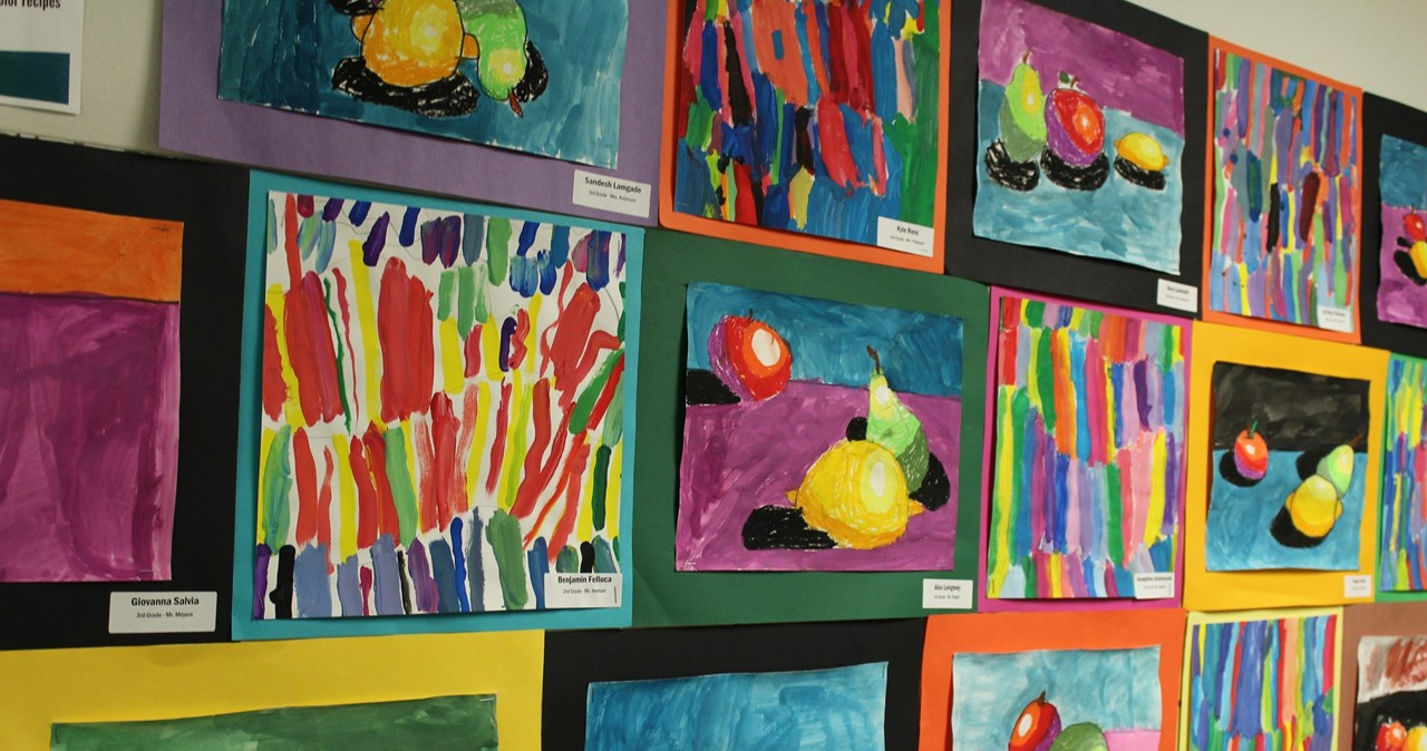Still life studies and dynamic color explorations hang in the hallway