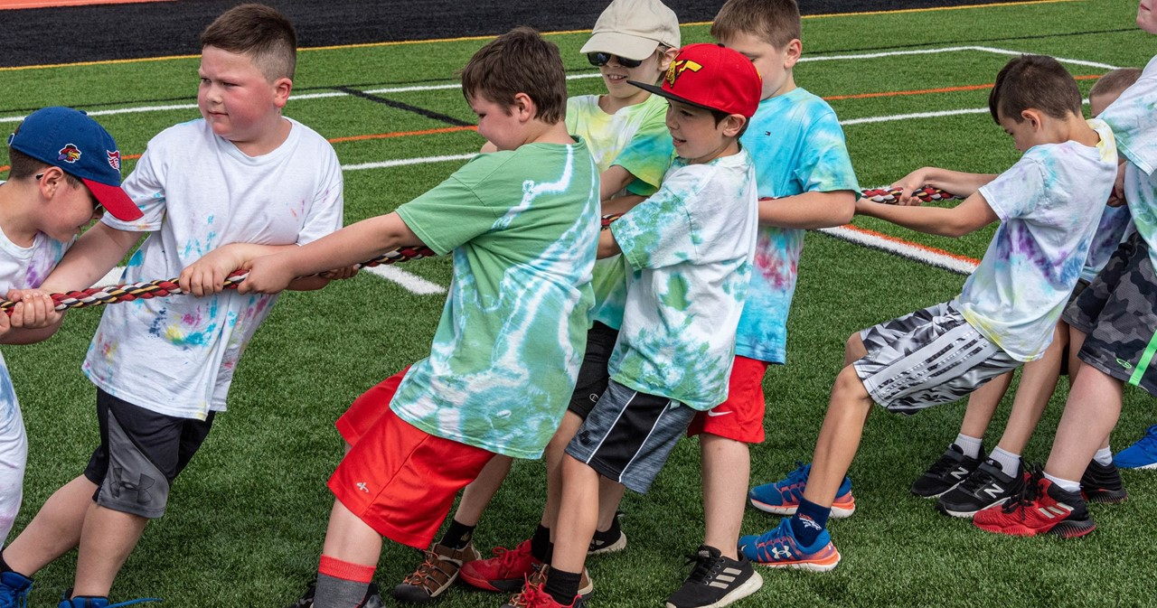 Students on the track playing tug of war