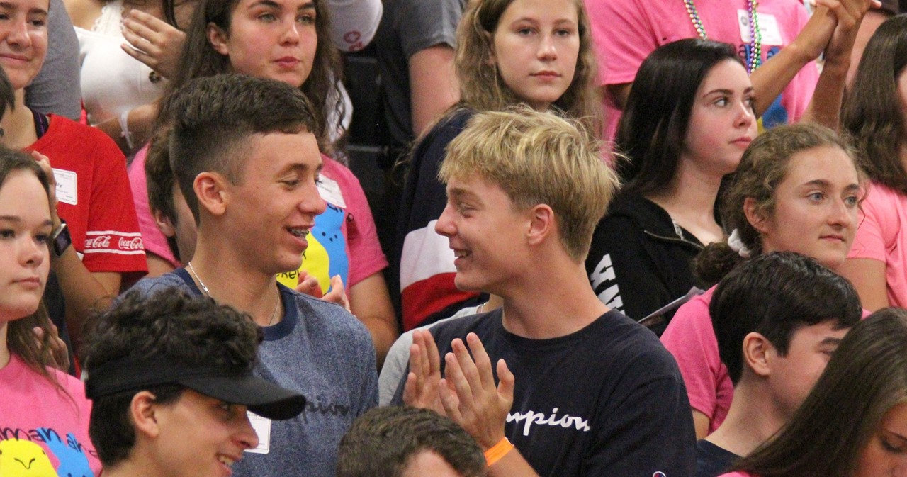 Two freshmen having fun in a crowd of ninth-graders at orientation