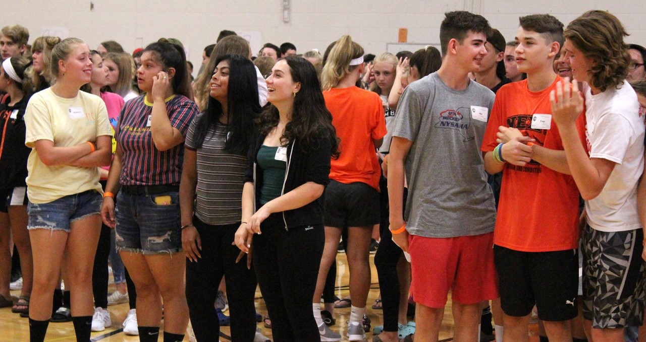 A line of freshmen during a getting-to-know-you exercise at orientation