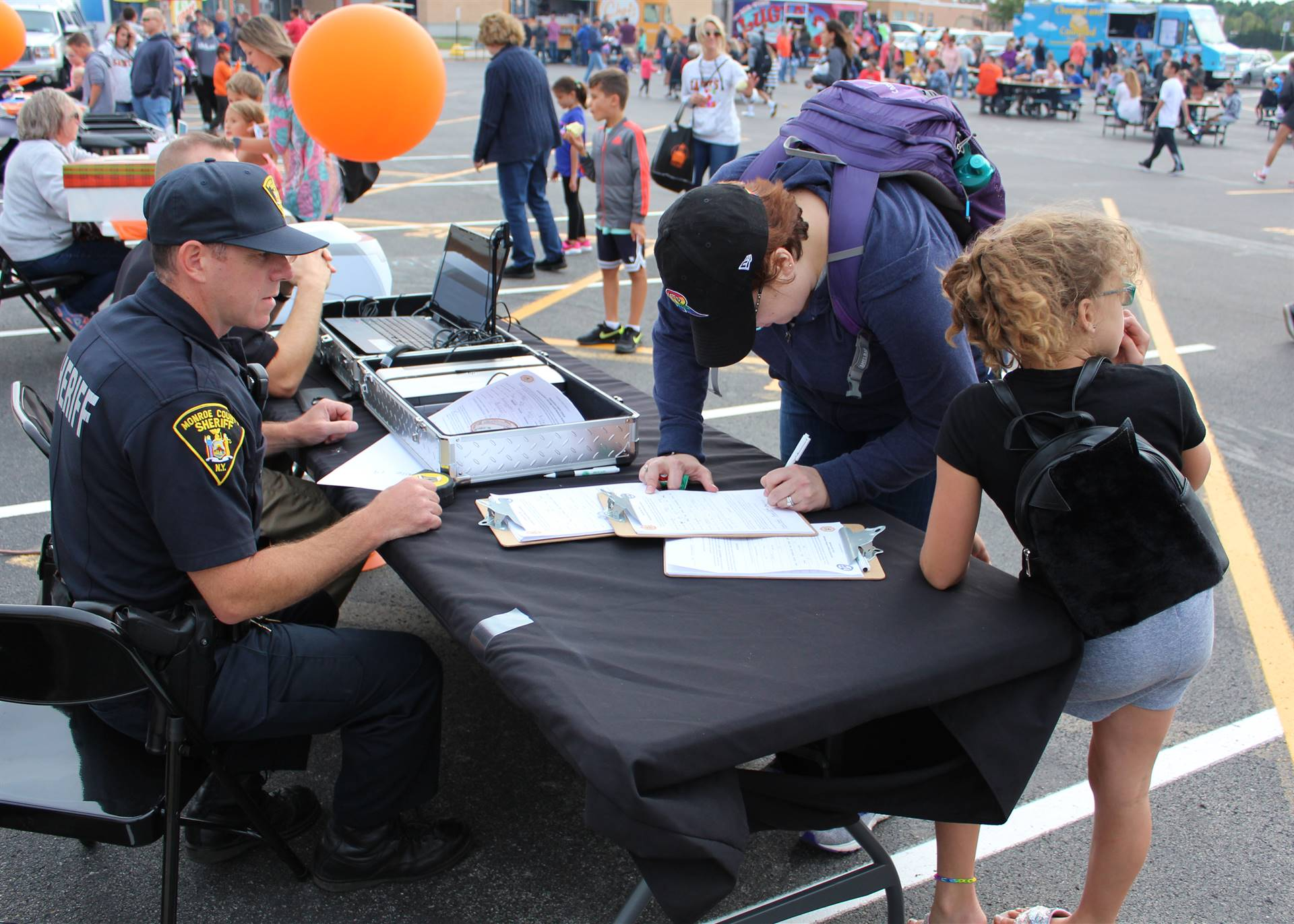 Visitors speak with community members at a table