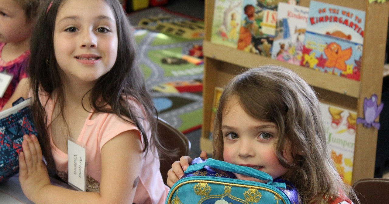 Two students at FRS with their lunchbags