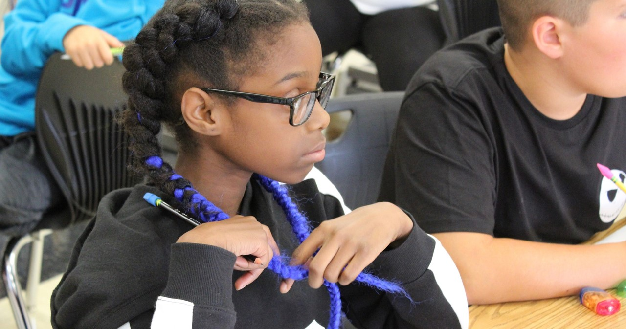 MS student with bright blue braids