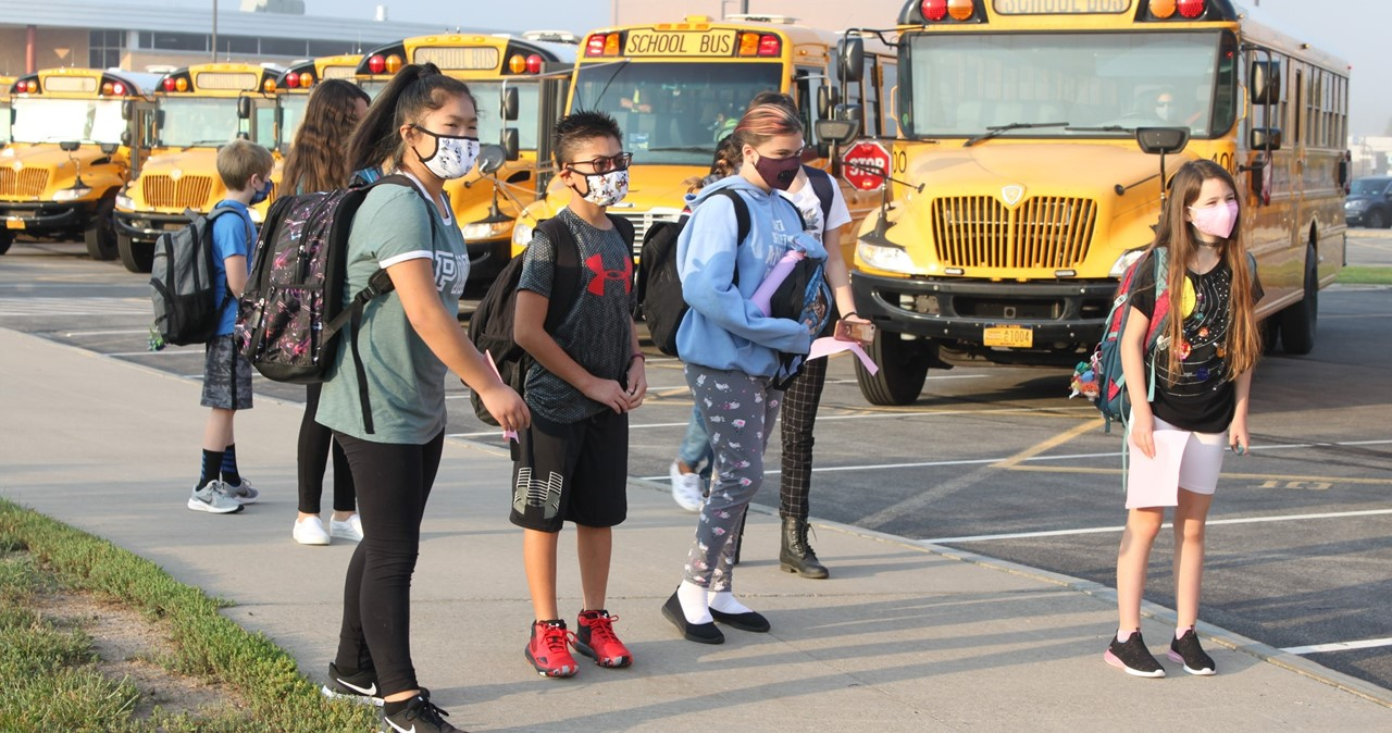 Students arriving at school near the bus loop
