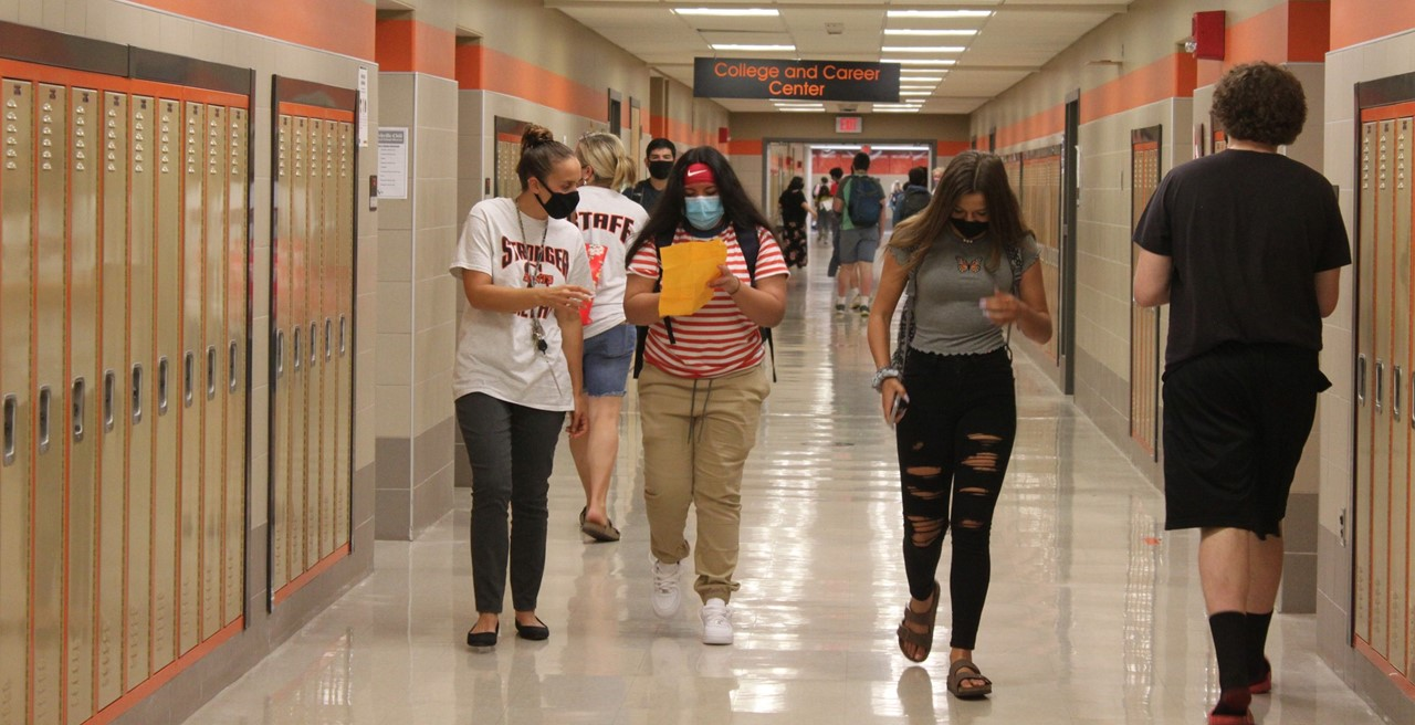 Students and staff in the hallway