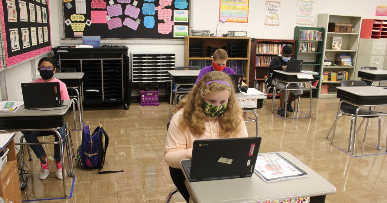 MS students working in a classroom