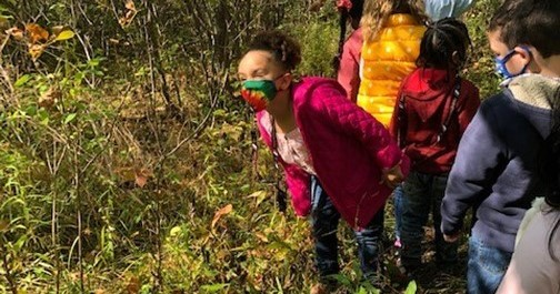 Group of students walking in the nature center