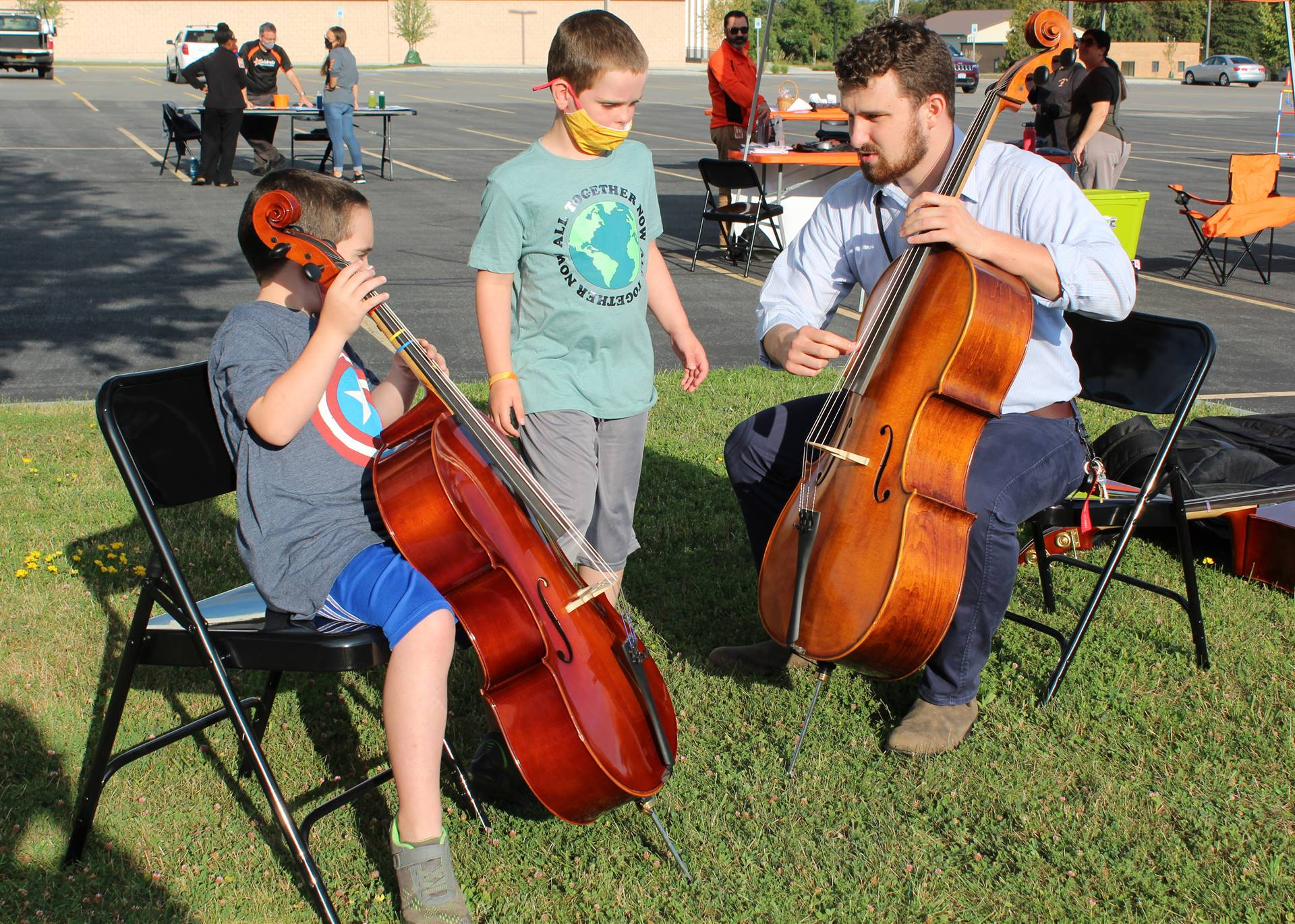 Students being introduced to string instruments